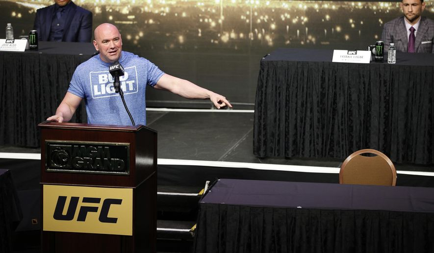 UFC president Dana White speaks beside an empty chair where Conor McGregor was supposed to sit during a news conference for UFC 200, Friday, April 22, 2016, in Las Vegas. (AP Photo/John Locher)