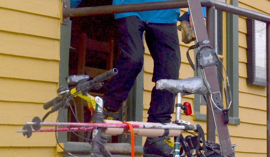 ADVANCE FOR USE SATURDAY, APRIL 23, 2016, AND THEREAFTER - In this Friday, April 15, 2016, photo, Craig Louis Perrinjaquet stands near his vintage Shasta mountain bicycle equipped with a pair of 36-year-old skis to carry out his morning ritual of skiing up and down a peak in Breckenridge, Colo. (Phil Lindeman/Summit Daily News via AP) MANDATORY CREDIT