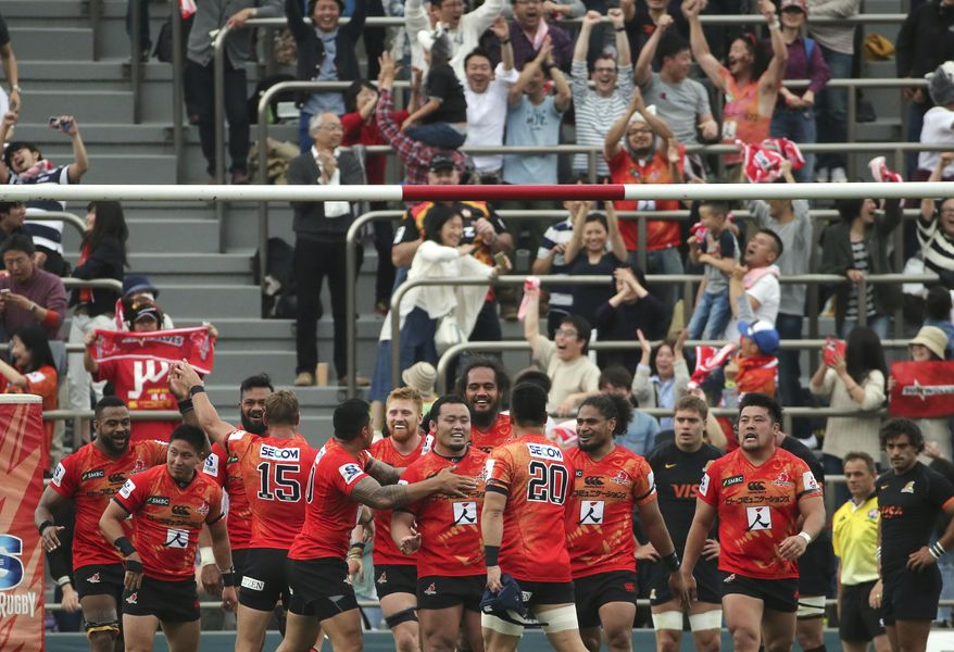 Players of Japan's Sunwolves celebrate their win over Argentina's Jaguares during their Super Rugby match in Tokyo, Saturday, April 23, 2016. The Sunwolves broke through for its first-ever win in the tournament, beating Jaguares 36-28. (AP Photo/Koji Sasahara)