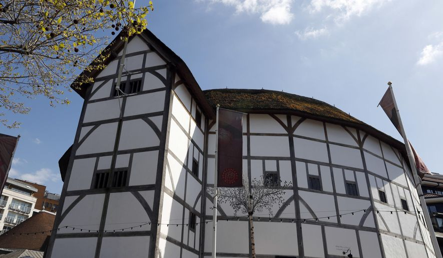 FOR JILL LAWLESS STORY BRITAIN SHAKESPEARE 400 -  A view of The Globe Theatre, nestled alongside contemporary buildings on the banks of the River Thames in London, in this photo dated Tuesday, April 19, 2016.  The 400th anniversary of the playwright's death on April 23, is being marked across Britain with parades, church services and of course, stage performances, as Shakespeare wrote the play's the thing, and today all the world may be contained on stage at the Globe Theatre. (AP Photo/Kirsty Wigglesworth)