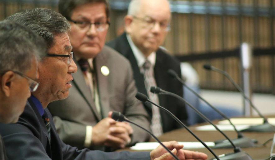 Navajo Nation President Russell Begaye, second from left, testifies before U.S. Sen. John McCain and U.S. Sen. John Barrasso, head of the Senate Committee on Indian Affairs, about actions by the Environmental Protection Agency that led to a mine spill polluting rivers in three Western states last summer, at the Phoenix city council chambers Friday, April 22, 2016. (AP Photo/Ryan Van Velzer)