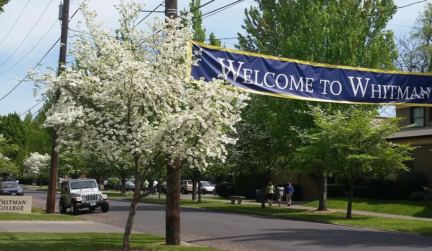 In this photo taken Thursday, April 21, 2016, signs designate the entrance to the Whitman College campus in Walla Walla, Wash. Whitman College, a private, liberal arts school, has dumped its long-time mascot. Whitman teams will no longer be called the Missionaries, which was a reference Marcus and Narcissa Whitman, missionaries who came to the Walla Walla Valley in 1836 and were massacred a decade later.    (Tom Skeen/Walla Walla Union-Bulletin via AP) MANDATORY CREDIT