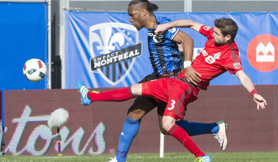 Toronto FC defender Drew Moor, right, stretches to knock the ball away from Montreal Impact forward Didier Drogba during the first half of an MLS soccer match, Saturday, April 23, 2016 in Montreal. (Paul Chiasson/The Canadian Press via AP) MANDATORY CREDIT