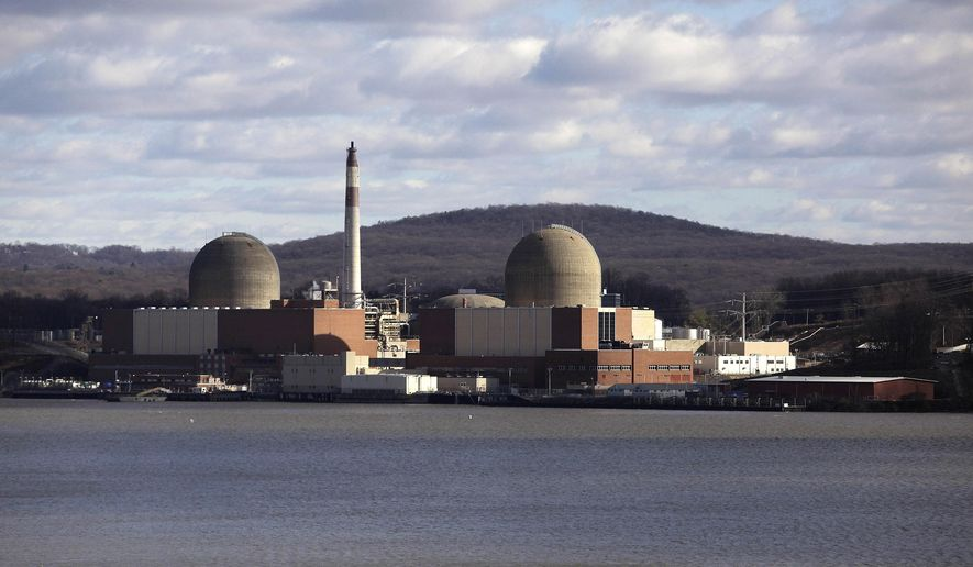 This Dec. 16, 2009 file photo shows the Indian Point nuclear power plant in Buchanan, N.Y., as seen from across the Hudson River in Tomkins Cove, N.Y. The nuclear plants that generate more than a quarter of New York's electricity are going through turbulent times. Different plants are being subsidized, vilified and targeted for long-term financial support amid slumping power prices. (AP Photo/Julie Jacobson)