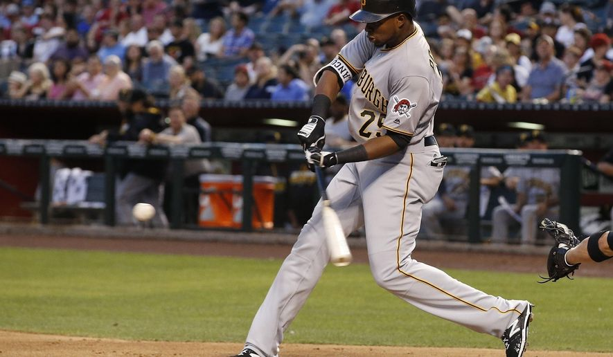 Pittsburgh Pirates' Gregory Polanco swings on a home run against the Arizona Diamondbacks during the second inning of a baseball game Friday, April 22, 2016, in Phoenix. (AP Photo/Ross D. Franklin)