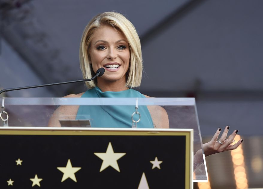 """FILE - In this Oct. 12, 2015 file photo,  Kelly Ripa addresses the crowd during a ceremony honoring her with a star on the Hollywood Walk of Fame  in Los Angeles. Ripa is returning to her daytime talk show, ending an absence that followed word her co-host, Michael Strahan, will join """"Good Morning America."""" She will be back Tuesday, April 26, 2016 on """"Live With Kelly and Michael,"""" she said in an email to the show's staff that was obtained by The Associated Press.(Photo by Chris Pizzello/Invision/AP)"""