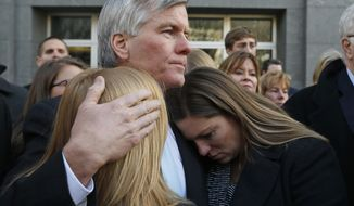 Former Virginia Gov. Bob McDonnell, center, hugs his daughters Cailin Young, left, and Jeanine McDonnell Zubowsky, right, after he was sentenced outside federal court in Richmond, Va., in this January 2015 file photo.  (AP Photo/Steve Helber, File) **FILE**