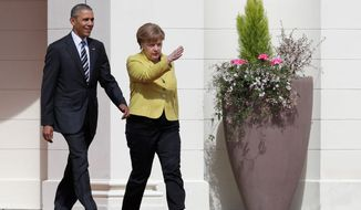 Onward: German Chancellor Angela Merkel welcomes President Obama to Herrenhausen Palace in Hanover during his final official trip to countries in the European Union. (Associated Press)