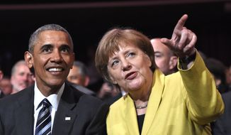 Then-U.S. President Barack Obama, left, and German Chancellor Angela Merkel chat during the opening of the Hannover Messe industry fair in Hannover, northern Germany, Sunday, April 24, 2016. Obama is on a two-day official visit to Germany. (AP Photo/Jens Meyer) ** FILE **