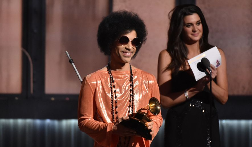 In this Feb. 8, 2015, file photo, Prince presents the award for album of the year at the 57th annual Grammy Awards in Los Angeles. (Photo by John Shearer/Invision/AP, File)