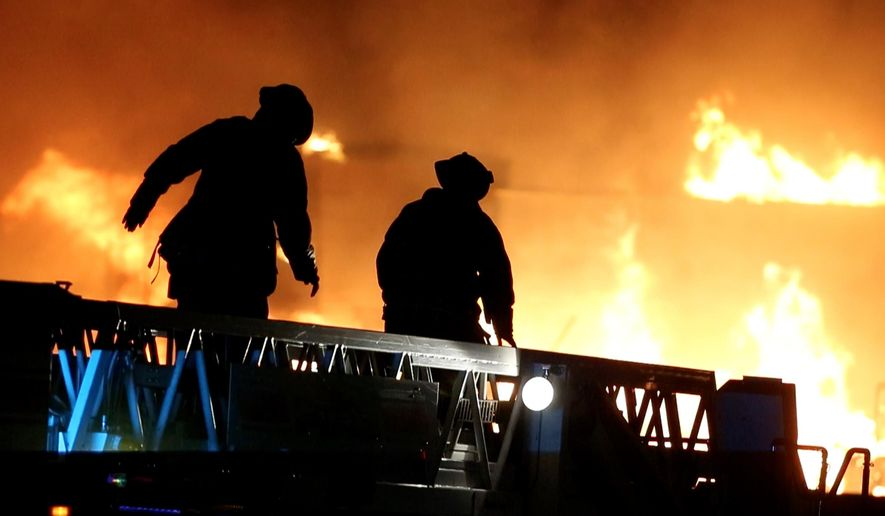 Fire crews battle a blaze in the Phoenix suburb of Gilbert, Ariz., Saturday, April 23, 2016. Evacuations have been ordered for homes near the major fire. (Cheryl Evans/The Arizona Republic via AP)  MARICOPA COUNTY OUT; MAGS OUT; NO SALES; MANDATORY CREDIT