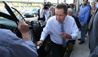 Republican presidential candidate John Kasich leaves the Penrose Diner in Philadelphia, Monday, April 25, 2016. (David Maialetti/The Philadelphia Inquirer via AP)