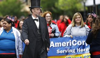 Abraham Lincoln impersonator Fritz Klein marches with AmeriCorps and Senior Corps members from across Illinois to mark the 20th anniversary of the AmeriCorps national service program on Sept. 12, 2014, in Springfield, Ill. (Associated Press)