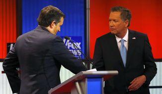 Republican presidential candidates, Sen. Ted Cruz, R-Texas, and Ohio Gov. John Kasich shake hands after a Republican presidential primary debate at Fox Theatre, Thursday, March 3, 2016, in Detroit. (AP Photo/Paul Sancya) ** FILE **
