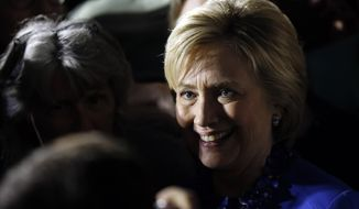 Democratic presidential candidate Hillary Clinton meets with attendees during a campaign stop, Monday, April 25, 2016, at City Hall in Philadelphia. (AP Photo/Matt Rourke)