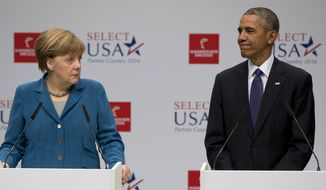 U.S. President Barack Obama and German Chancellor Angela Merkel look to each other as they speak before their tour of the Hannover Messe Trade Fair, the world's largest industrial technology trade fair, in Hannover, northern Germany, Monday April 25, 2016. Obama is on a two-day official visit to Germany. (AP Photo/Carolyn Kaster)