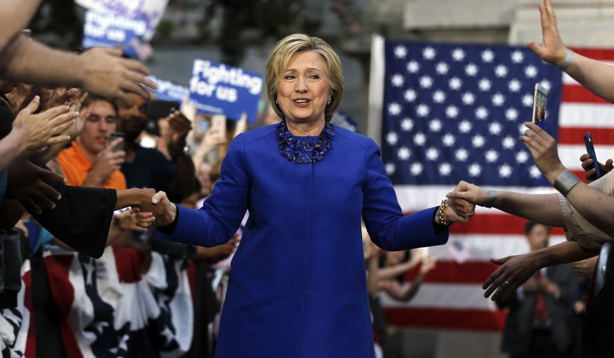 """""""I am going to have a Cabinet that looks like America, and 50 percent of America is women,"""" Hillary Clinton said. (Associated Press)"""