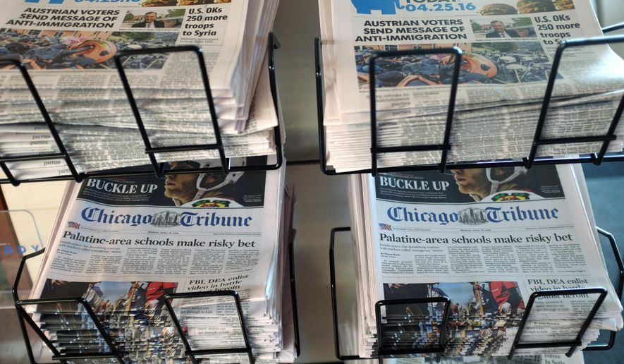USA Today, Chicago Tribune and other newspapers are displayed at Chicago's O'Hare International Airport, Monday, April 25, 2016, in Chicago. (AP Photo/Kiichiro Sato)