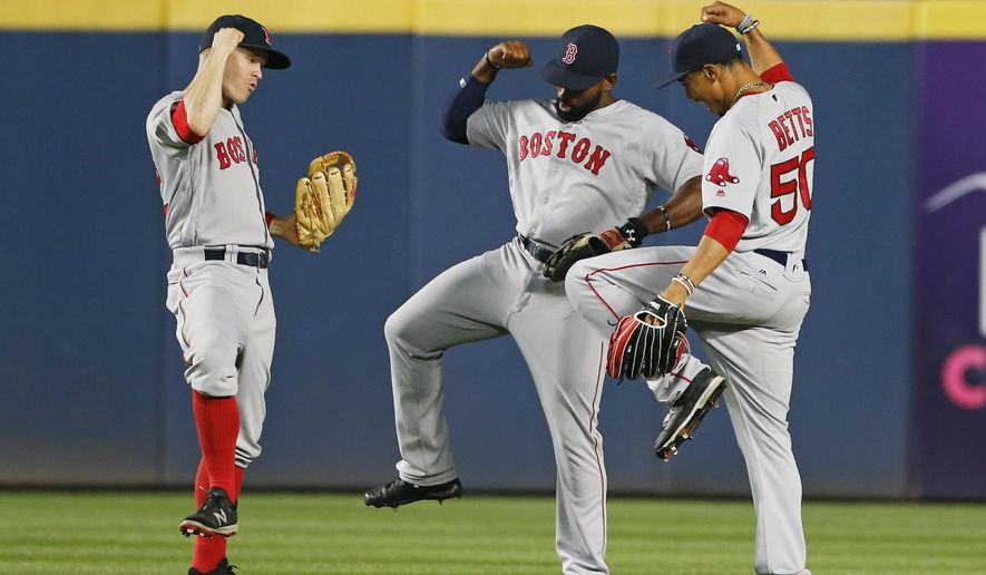 Boston Red Sox outfielders, from left, left fielder Brock Holt (12), center fielder Jackie Bradley Jr. (25) and right fielder Mookie Betts (50) celebrate after defeating the Atlanta Braves, 1-0, in a baseball game Monday, April 25, 2016, in Atlanta. Bradley scored the game's only run with a solo-home run in the seventh inning. (AP Photo/John Bazemore)