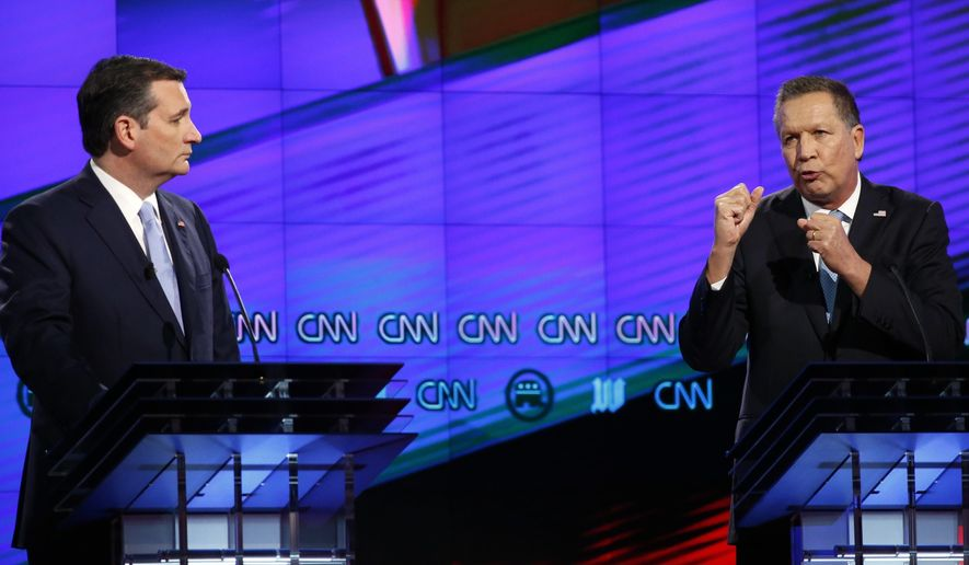 """FILE - In this March 10, 2016, file photo, Republican presidential candidate Ohio Gov. John Kasich, right, speaks as Republican presidential candidate, Sen. Ted Cruz, R-Texas, listens, during a Republican presidential debate sponsored by CNN, Salem Media Group and the Washington Times at the University of Miami in Coral Gables, Fla. Declaring the Republican presidential contest at """"a fork in the road,"""" Cruz and Kasich defended their extraordinary new alliance on April 25 as the party's last, best chance to stop Donald Trump, even as the New York billionaire surged toward another big delegate haul. (AP Photo/Wilfredo Lee, File)"""