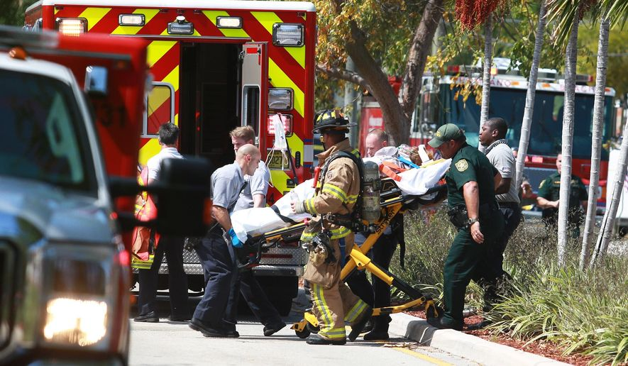 A person is transported to the hospital after a plane crashed into a house in Pompano Beach, Fla., Monday, April 25, 2016. (Carline Jean/The South Florida Sun-Sentinel via AP) SOUTH FLORIDA OUT; NO MAGS; NO SALES; NO INTERNET; NO TV
