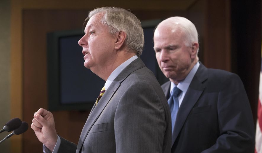 In this Feb. 24, 2016, file photo, Republican members of the Senate Armed Services Committee, Sen. Lindsey Graham, R-S.C., center, and committee chairman John McCain, R-Ariz., speak at a news conference on Capitol Hill in Washington. (AP Photo/J. Scott Applewhite, File)