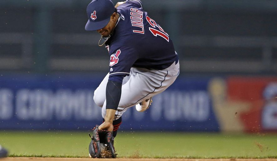 Cleveland Indians shortstop Francisco Lindor fields a grounder by Minnesota Twins' Eduardo Nunez in the third inning of a baseball game Monday, April 25, 2016, in Minneapolis. Lindor threw out Nunes. (AP Photo/Jim Mone)