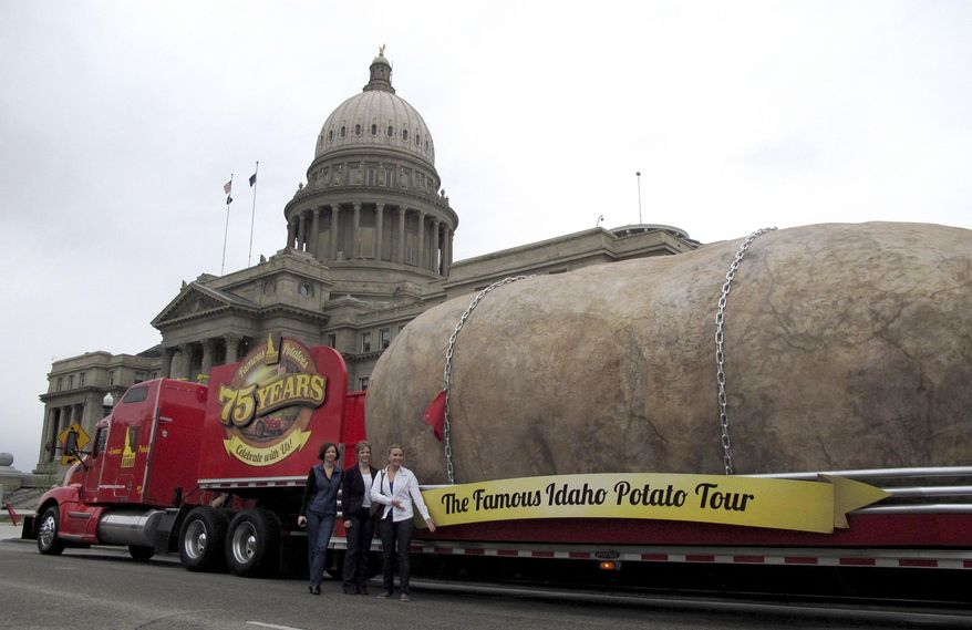 FILE - In this March 30, 2012, file photo, the Idaho Potato Commission displays its six-ton tuber replica on the street in front of the Idaho Capitol in Boise. The Idaho Potato Commission says its traveling advertisement, the Great Big Idaho Potato Truck, could roll on indefinitely. (AP Photo/John Miller, File)