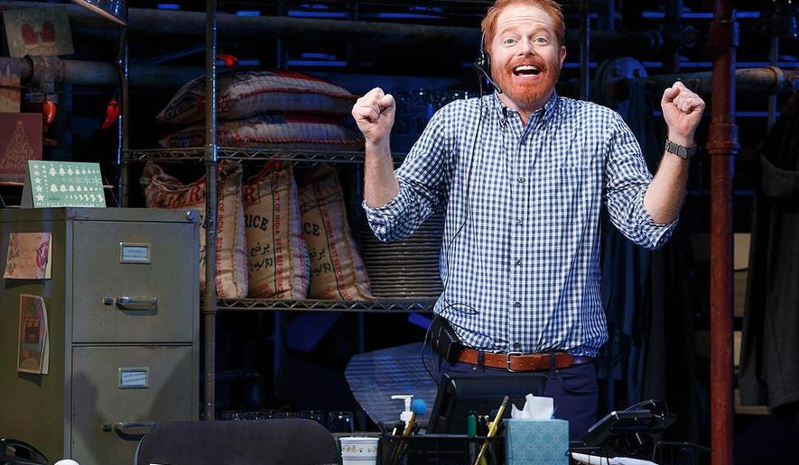 "This image released by Polk and Co. shows Jessie Tyler Ferguson in a scene from his one-man show, ""Fully Committed,"" at the Lyceum Theatre in New York. (Joan Marcus/Polk and Co. via AP)"