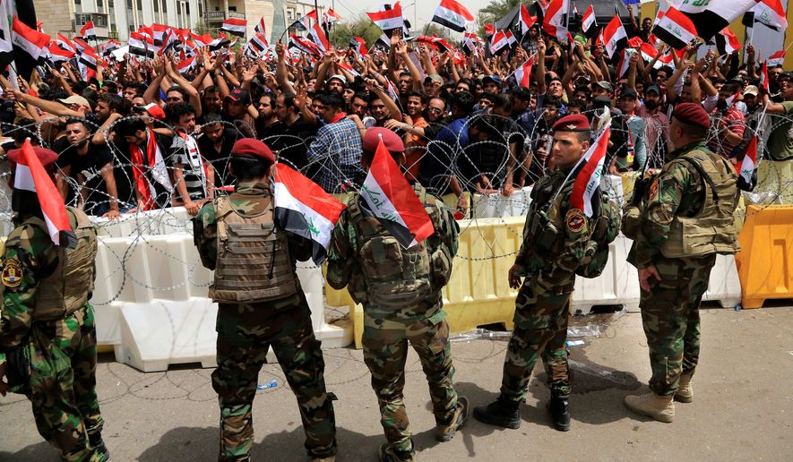 Iraqi Security Forces guard the heavily fortified Green Zone on Tuesday as followers of Iraq's influential Shiite cleric Muqtada al-Sadr demonstrate. (Associated Press)