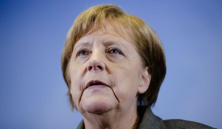 German Chancellor Angela Merkel briefs the media after a visit at Germany's Joint Terrorism Defense Center GATZ (Gemeinsames Terrorismusabwehrzentrum), in Berlin, Tuesday, April 26, 2016. (AP Photo/Markus Schreiber, Pool)