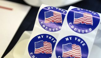 Stickers for voters are seen on a table at a polling station Tuesday, April 26, 2016 in Wayne, Pa. Attention is shifting from a well-worn campaign trail to the voting booths as Pennsylvanians cast ballots Tuesday on presidential primary contests, including the first competitive Republican primary in decades, and races for Congress and state offices. (AP Photo/Jacqueline Larma)