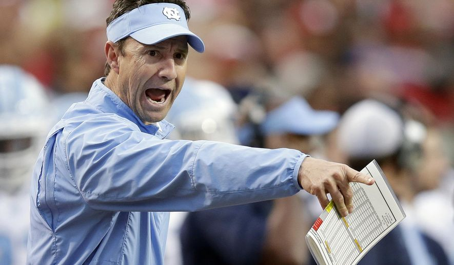 FILE - In this Nov. 28, 2015, file photo, North Carolina coach Larry Fedora yells at an official during the first half an NCAA college football game against North Carolina State in Raleigh, N.C. Fedora's team became the fifth different team in as many seasons to win the Coastal Division last year. (AP Photo/Gerry Broome, File)