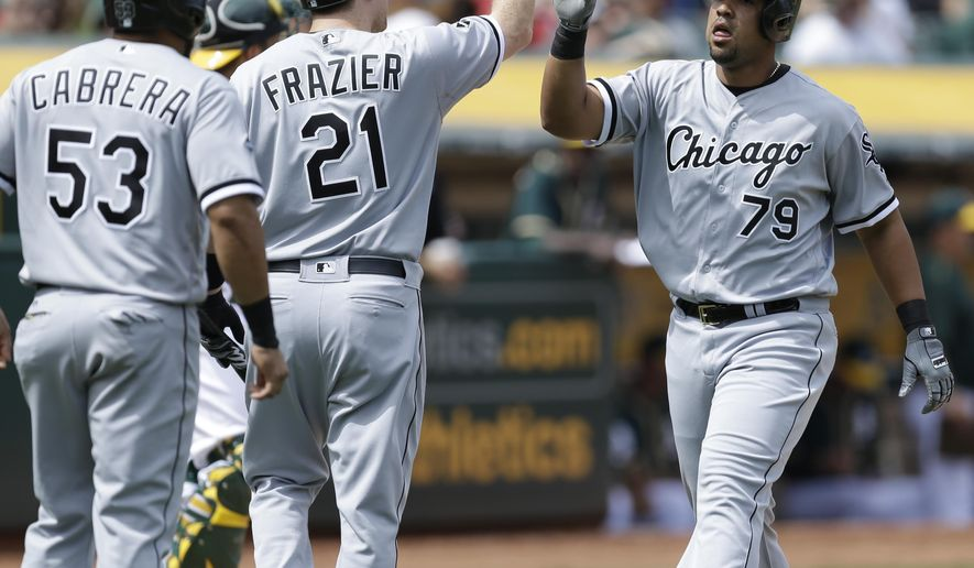 FILE - In this Thursday, April 7, 2016 file photo, Chicago White Sox's Jose Abreu, right, is congratulated by Todd Frazier (21) and Melky Cabrera (53) after hitting a two run home run off Oakland Athletics' Kendall Graveman in the sixth inning of a baseball game in Oakland, Calif. A recently unsealed grand jury indictment against three men provides fresh details about the smuggling of 17 Cuban players, among them Jose Abreu of the Chicago White Sox and Leonys Martin of the Seattle Mariners, Tuesday, April 26, 2016.(AP Photo/Ben Margot, File)