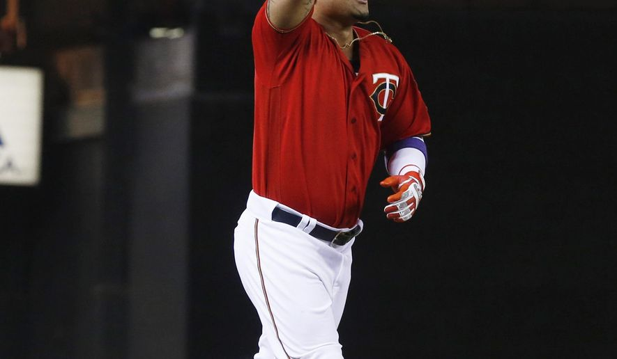 Minnesota Twins' Oswaldo Arica celebrates his walk off solo home run off Cleveland Indians pitcher Zach McAllister as the Twins beat the Cleveland Indians 4-3 in a baseball game Monday, April 25, 2016, in Minneapolis. (AP Photo/Jim Mone)