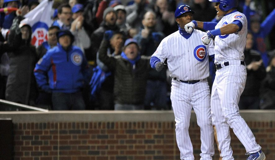 Chicago Cubs' Addison Russell celebrates at third base after hitting a two RBI triple during the sixth inning of a baseball game against the Milwaukee Brewers, Tuesday, April 26, 2016, in Chicago. (AP Photo/Paul Beaty)