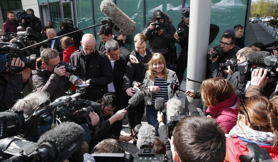"""Chair of the Hillsborough Families Support Group, Margaret Aspinall, speaks to the media outside the Hillsborough Inquest in Warrington, England, Tuesday April 26, 2016. The 96 Liverpool soccer fans who died in the Hillsborough Stadium disaster were """"unlawfully killed"""" because of errors by the police, a jury concluded Tuesday. (Owen Humphreys/PA via AP) UNITED KINGDOM OUT"""