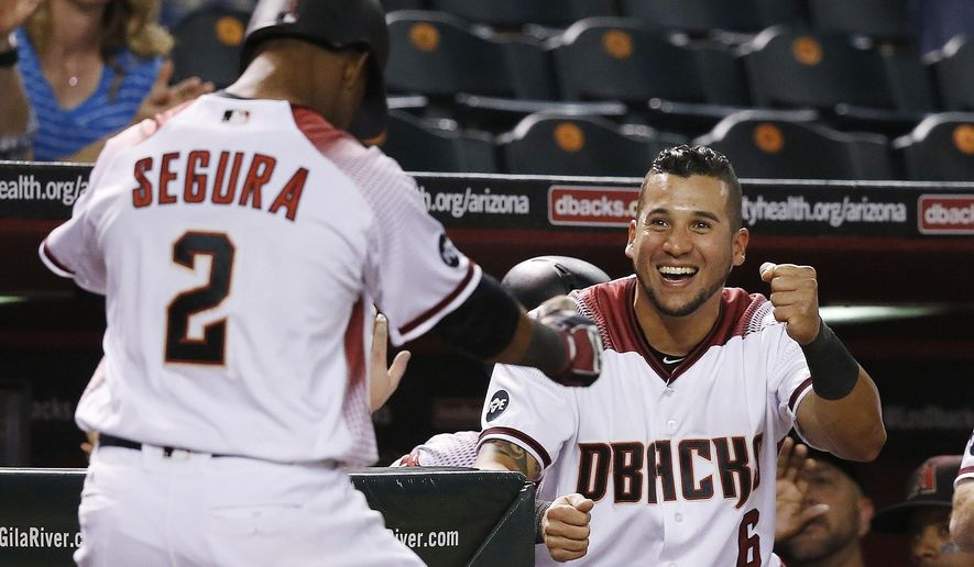 Arizona Diamondbacks' Jean Segura (2) celebrates his three-run home run against the St. Louis Cardinals with David Peralta (6) during the sixth inning of a baseball game Monday, April 25, 2016, in Phoenix. (AP Photo/Ross D. Franklin)