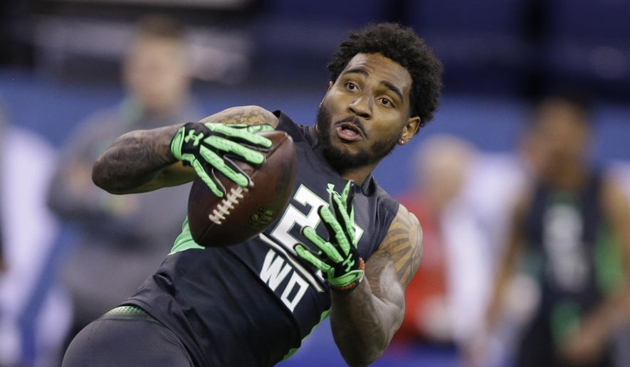 FILE - In this Feb. 27, 2016 file photo, Ohio State receiver Braxton Miller runs a drill at the NFL football scouting combine in Indianapolis. The facts about Miller's potential NFL career are clear: a transition from star quarterback at Ohio State to maybe wide receiver as a pro. He's sharing the journey with fans through a 360-degree virtual reality video. (AP Photo/Darron Cummings, File)