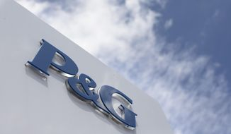 FILE - This July 9, 2015, file photo, shows signage outside Procter & Gamble corporate headquarters in downtown Cincinnati. Procter & Gamble reports financial results, Tuesday, April 26, 2016. (AP Photo/John Minchillo, File)
