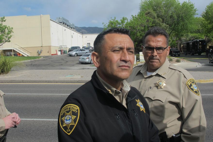 Bernalillo County Sheriff Manuel Gonzales discusses an officer-involved shooting that killed a suspect wanted on an arrest warrant at an apartment complex in Albuquerque, N. M., Tuesday, April 26, 2016. No law enforcement officers were injured or wounded in the shooting. (AP Photo/Mary Hudetz)