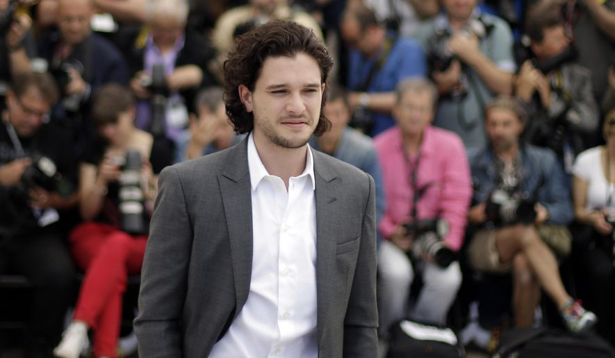 "FILE- In this May 16, 2014 file photo, actor Kit Harington poses for photographers during a photo call for How to Train Your Dragon 2 at the 67th international film festival in Cannes, southern France. Kit Harington has gone from blood and gore in ""Game of Thrones"" to blood and gore in English Elizabethan drama. (AP Photo/Thibault Camus, File)"