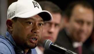 FILE - In this Oct. 20, 2015 file photo, Tiger Woods responds to a question during a press conference in Mexico City. Tiger Woods registered for the U.S. Open, which was more procedure than pronouncement. Three weeks later, he played five holes during the official opening of the golf course he designed outside Houston. The next step is returning to competition, which remains unknown. (AP Photo/Rebecca Blackwell, File)