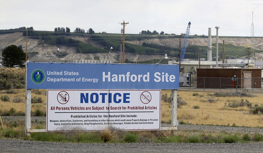 FILE - In this July 9, 2014, file photo, a sign informs visitors of prohibited items on the Hanford Nuclear Reservation near Richland, Wash. Officials for the Hanford Nuclear Reservation are trying to determine if a second giant underground tank containing radioactive waste from the production of plutonium for nuclear weapons is leaking, the U.S. Department of Energy revealed on Tuesday, April 26. (AP Photo/Ted S. Warren, File)