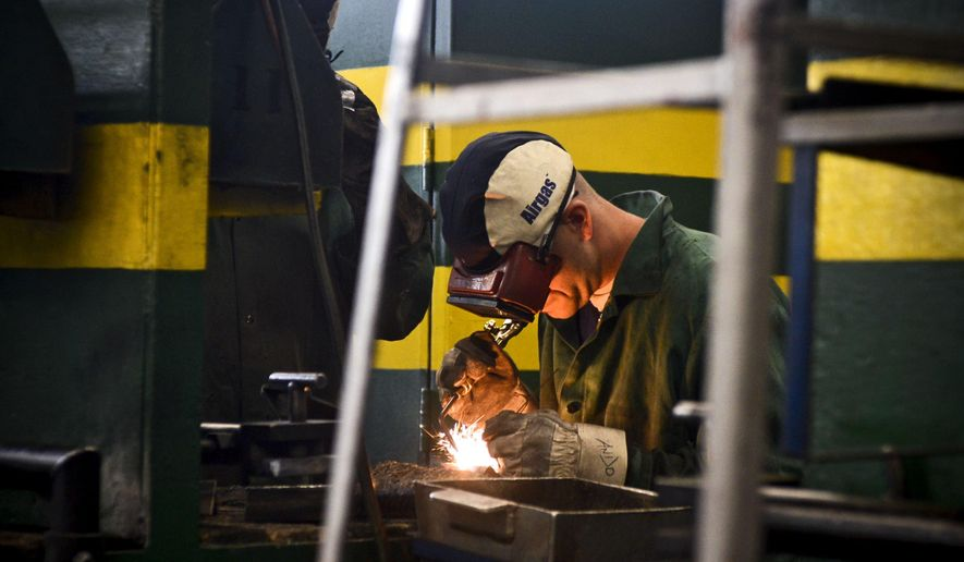 In this photo taken Monday, April 25, 2016, inmates practice learning the trade of welding through the Vocational Village program at the Richard A. Handlon Correctional Facility in Ionia, Mich. The vocational program enrolls eligible prisoners in career-worthy technical education such as welding, carpentry and automotive technology. Inmates are housed together to foster a supportive, learning environment. (Emily Rose Bennett/The Grand Rapids Press via AP) ALL LOCAL TELEVISION OUT; LOCAL TELEVISION INTERNET OUT; MANDATORY CREDIT