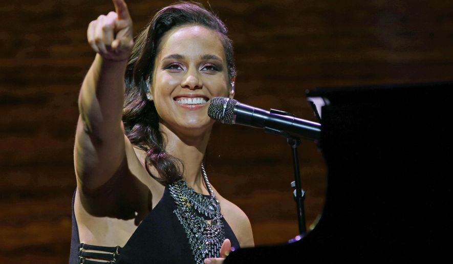 FILE - In this March 23, 2016 file photo, singer Alicia Keys performs at the coffee company's annual shareholders meeting in Seattle. Keys will debut new music at the upcoming UEFA Champions League Final in Milan, Italy on May 28. (AP Photo/Ted S. Warren, File)