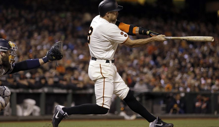 San Francisco Giants' Hunter Pence swings for an RBI sacrifice fly off San Diego Padres' Luis Perdomo in the fifth inning of a baseball game Monday, April 25, 2016, in San Francisco. (AP Photo/Ben Margot)