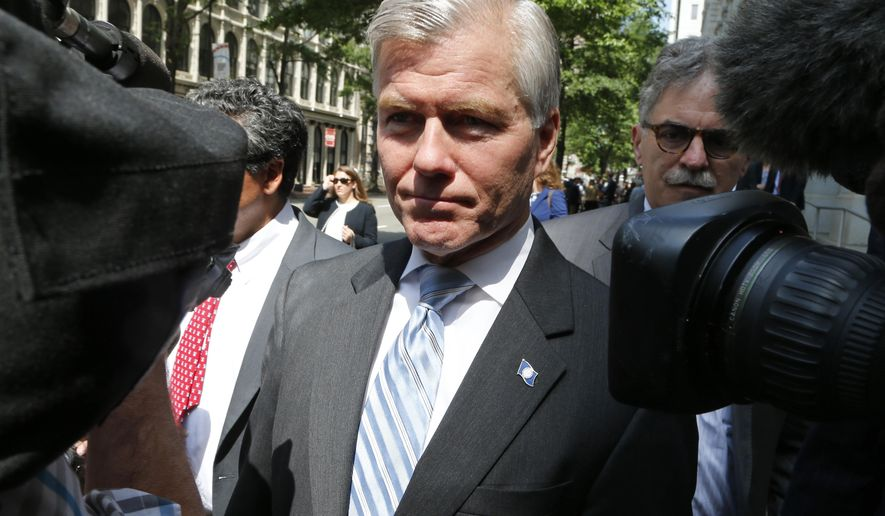 FILE -In this May 12, 2015 file photo, former Virginia Gov. Bob McDonnell navigates a group of cameras as he leaves the 4th U.S. Circuit Court of Appeals in Richmond, Va. The Supreme Court will decide how far politicians can go in doing favors for people who give them money as it takes up the public corruption case of McDonnell. (AP Photo/Steve Helber, File)
