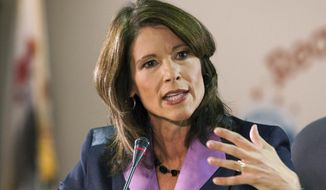 In this Oct. 17, 2012, file photo, U.S. Rep. Cheri Bustos, D-Ill., speaks in Rockford, Ill. (Scott Morgan/Rockford Register Star via AP, File)