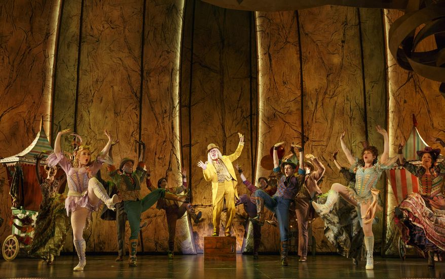 """This image released by Matt Ross Public Relations shows Terrence Mann, center, and the cast during a performance of """"Tuck Everlasting,"""" in New York. (Joan Marcus/Matt Ross Public Relations via AP)"""